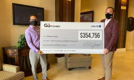 Daniel Negreanu presents donation check image
